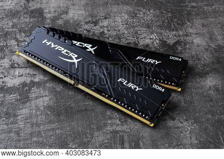Varna, Bulgaria, January 11, 2021. Two Ram Memory Modules Kingston Hyperx Fury Ddr4 On A Dark Backgr