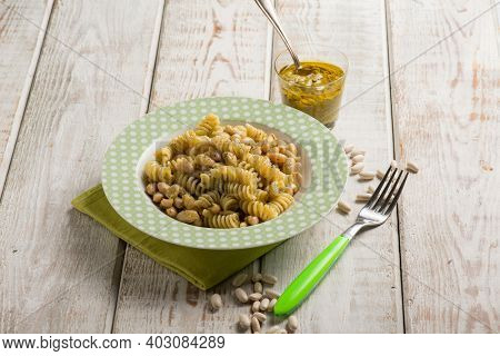 fusilli pasta with pesto sauce and white beans
