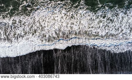 Amazing Picturesque View Of Black Sand Beach With Wave Of Atlantic Ocean In Iceland. Aerial Winter L