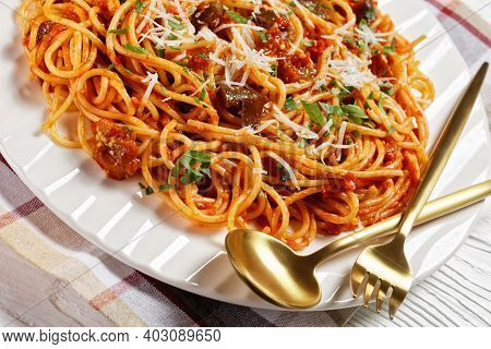 Pasta Alla Norma, Classic Sicilian Pasta Dish Of Sauteed Eggplant Tossed With Tomato Sauce And Toppe