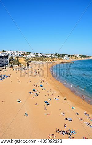 Albufeira, Portugal - June 6, 2017 - Elevated View Of The Beach With Tourists Enjoying The Setting A