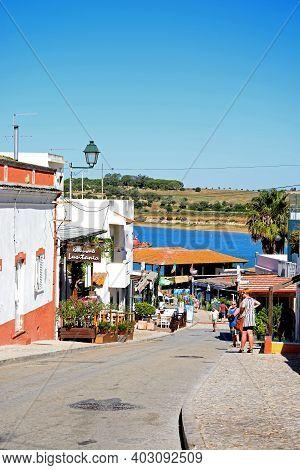 Alvor, Portugal - June 7, 2017 - Village Street With Views Towards The Fish Market And Estuary, Alvo