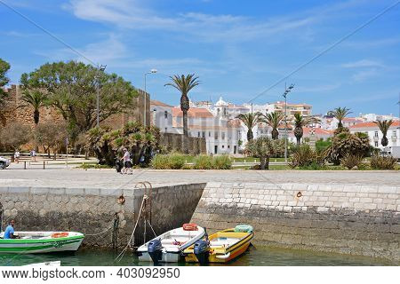 Lagos, Portugal - June 9, 2017 - Small Boats Moored Along The River Bensafrim With The Governors Pal