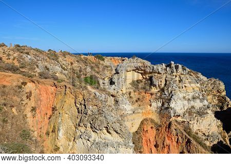 Lagos, Portugal - June 10, 2017 - Elevated View Of The Cliffs With The Ocean To The Rear, Ponta Da P