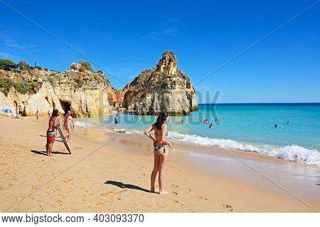 Portimao, Portugal - June 10, 2017 - Tourists Relaxing On The Beach And In The Sea, Praia Da Rocha,