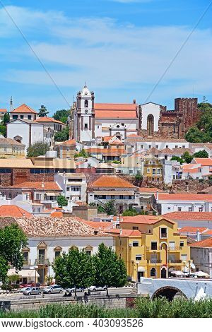 Silves, Portugal- June 10, 2017 - View Of Town Buildings With The Gothic Cathedral (igreja Da Miseri