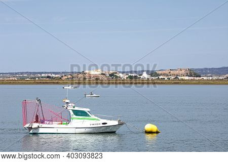 Ayamonte, Spain - June 11, 2017 - Small Boats Moored On The River With Views Towards Castro Marim In