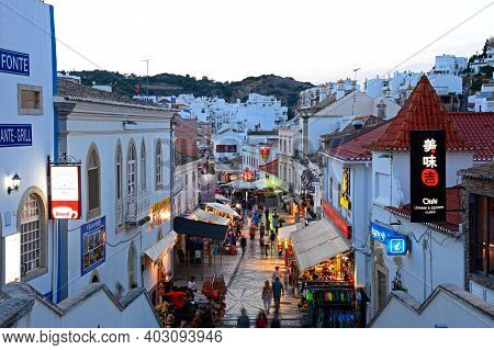 Albufeira, Portugal - June 12, 2017 - Elevated View Of The R 5 De Outubro Shopping Street In The Eve