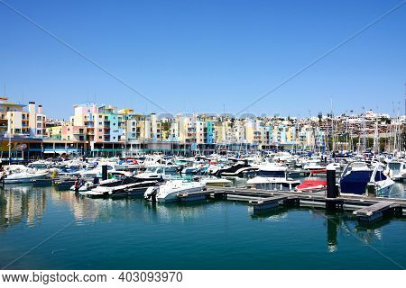 Albufeira, Portugal - June 12, 2017 - Boats And Yachts Moored In The Marina With Buildings To The Re