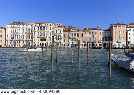 Venice, Italy - September 21, 2017: Grand Canal, Vintage Buildings, Parked Boats At The Marina. Cana