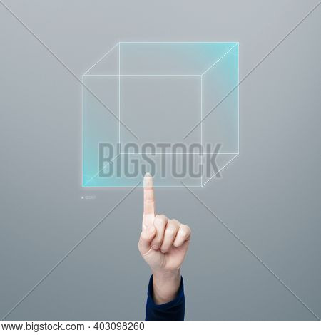 Hand pointing at cubic hologram digital technology