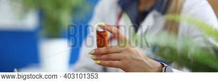 Close-up Of Doctor Hand Holding Capsules In Tube. Practitioner Prescribing Pills To Increase Immunit