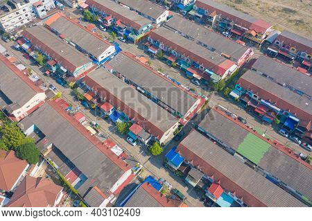 Aerial View Of Commercial Building, Townhouse Or Townhome. Urban Housing Development From Above. Top