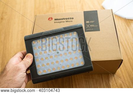 Paris, France - Dec 8 2020: Pov Male Hand Unboxing Unpacking New Manfrotto Led Light Lykos 2.0, 2 In