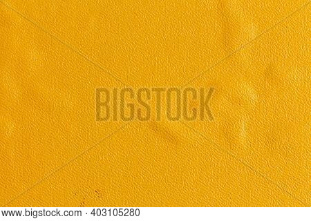 Yellow Textured Surface Of An Old Book With A Defect After Getting Wet