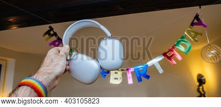 Paris, France - Jan 7, 2020: Wide Image - Happy Birthday Sign Hanged In Room With Apple Computers Ai