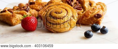Bakery Pastries, Strawberries On Marble Table. Freshly Cooked Bakery. Home Cooked Bakery For Morning