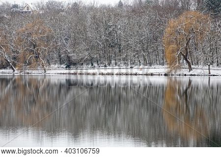 BARANYA, HUNGARY - JANUARY 2021: Beautiful snowing winter landscape with the lake in Pécs, Hungary.