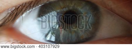Close-up Of Persons Eye. Macro Shot Of Beautiful Glance Of Woman. Light Green And Blue Colour Of Eye