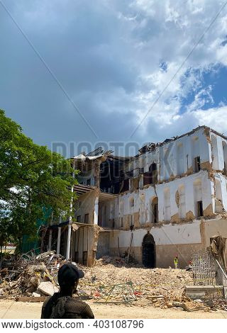 A Man Looking At House Of Wonders In Zanzibar Destroyed During Reconstruction