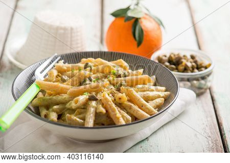 pasta with ricotta cheese capers and grated orange peel