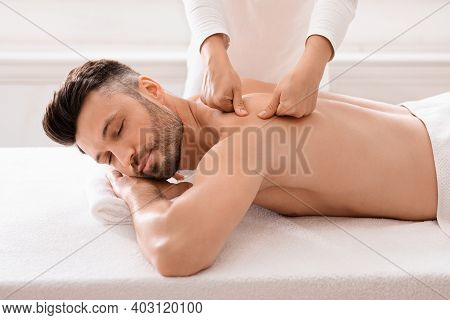 Middle Aged Bearded Man Attending Modern Male Spa, Laying On Massage Table, Getting Healing Body Pro