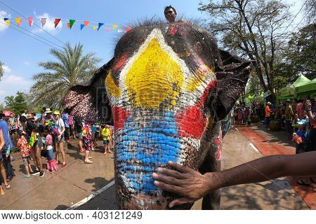 Ayutthaya, Thailand - 14 April 2019: Colors On The Heads Of Young Elephants That Play In The Water.