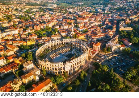 Aerial drone photo of famous european city of Pula and arena of roman time. Location Istria county, Croatia, Europe. Popular touristic place. UNESCO world heritage site. Discover the beauty of earth.