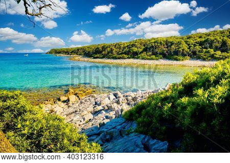 Awesome wild beach with azure water in luxurious lagoon on sunny day. Location place Punta Kriza, Cres island, Kvarner bay, Croatia, Europe. Exotic photo wallpapers. Discover the beauty of earth.