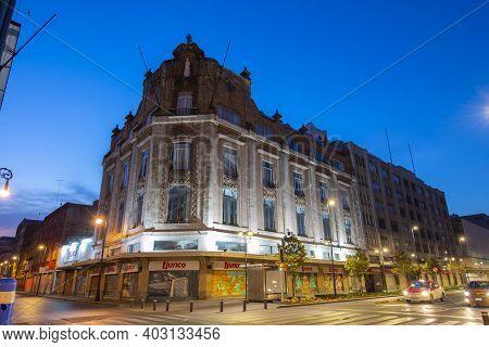 Mexico City - Jan. 18, 2020: Historic Buildings At Night On Avenida 20 De Noviembre At Calle De Venu