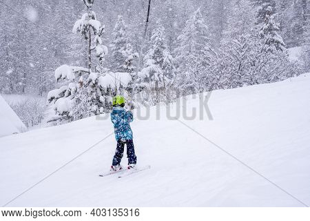 A Girl Lifting On The Ski Drag Lift Rope In Blue Sport Outfit On The Ski Resort Mountain Do A Ski Le