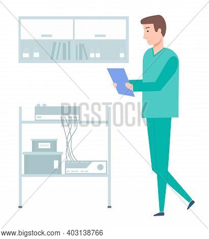 Doctor With Clipboard. A Professional Works With Special Equipment In A Medical Institution. A Man R