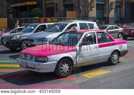 Mexico City - Jan. 14, 2020: Pink Cdmx Taxi In Historic Center Of Mexico City Cdmx, Mexico. Historic