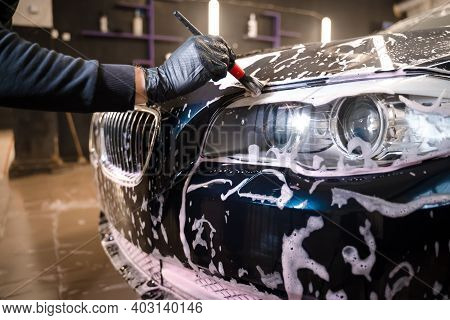 Detailed Car Wash. Detailing Concept.  Car Wash Employee Washes Hard-to-reach Places Of The Car With