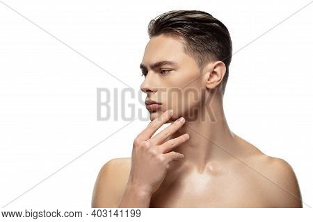 Thoughtful. Portrait Of Young Man Isolated On White Studio Background. Caucasian Attractive Male Mod
