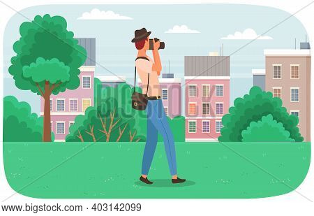 A Man In Hat Taking A Photo Of Landscape. Photographer Taking A Picture In The City Park. Nature Pho
