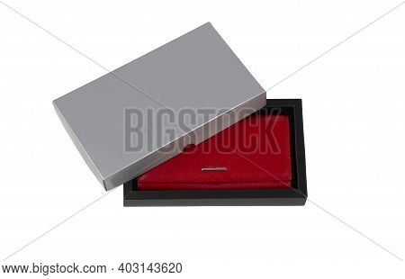 A New Red Female Leather Wallet For Banknotes And Plastic Cards In A Opened Black Gift Box Isolated