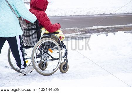 Disabled Handicapped Man Has A Hope. He Sits In A Wheelchair. The Complexity Of The Movement Of The