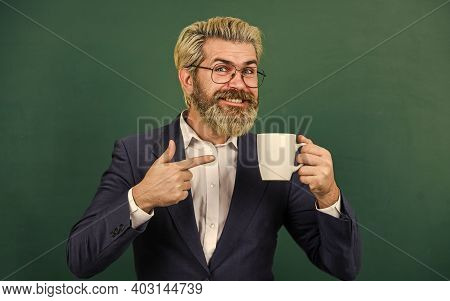 Coffee Addicted. Teacher In Glasses Drink Coffee Chalkboard Background. Energy Charge For Whole Day.