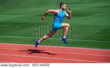 Sportsman Runner Outdoor. Health Care. Energy. Muscular Guy Run To Success. Man Running On Stadium.