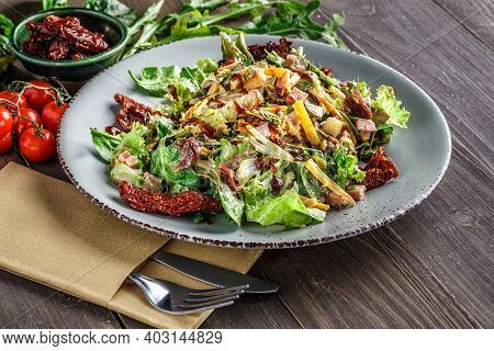 Green Vegan Salad From Green Leaves Mix And Vegetables. Top View. Salad Recipes. Healthy Vegan Food.