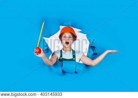 Pure Contractor. Kid Wear Helmet On Construction Site. Teen Girl Builder With Building Tool Tape Mea