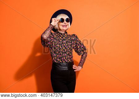 Photo Of Good Mood Happy Smiling Positive Old Woman Look Copyspace Wear Sunglasses Isolated On Orang