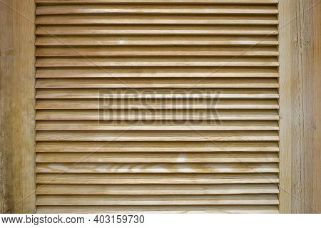 Wooden Shutters. Window With Wooden Doors To Protect From Sunlight. Background With Textured Narrow