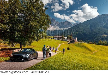Awesome Alpine Highlands In Sunny Day. Breathtaking View Of Church Of Santa Maddalena. Luxury Car An
