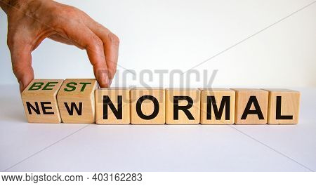 New Best Normal Symbol. Hand Turns Cubes And Changes Words 'new Normal' To 'best Normal'. Business A