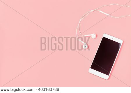 Mockup And Flat Lay Template With White Color Phone Smartphone And Headphones On Pink Background Wit
