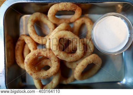 Onion Rings In Batter On Plate In Pub