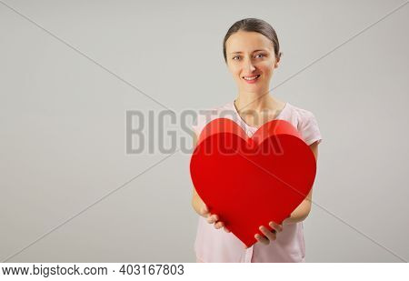 Many Red Hearts One Inside The Other, The Concept Of Growing Big Love, On Pink Background