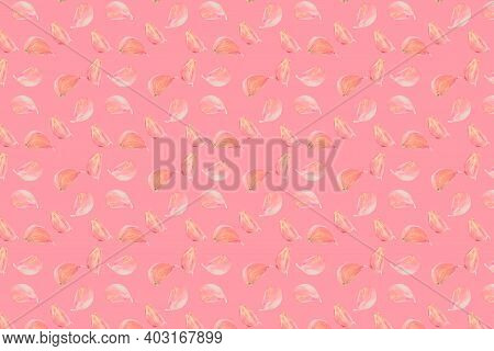 Garlic Cloves Pattern On Pastel Pink Color Background. Minimal Flat Lay Food Texture